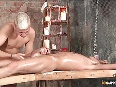Bound boy coated in oil and jerked off tubes