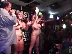 Naked babes in a bar sprayed with water tubes