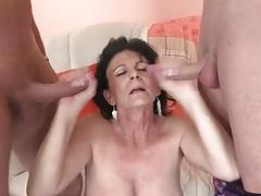 Pretty mature lady in stockings sucks dicks tubes