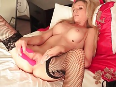 Naked milf with a perfect body fucks a toy tubes