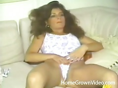 Vintage milf in a sexy one piece swimsuit plays tubes