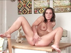 Teen pussy is pink and wet as she fingers tubes