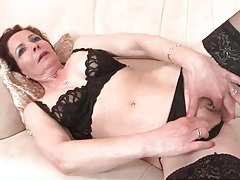Mature dressed up in black lingerie tubes