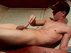 Masturbating boy cums on a glass table tubes