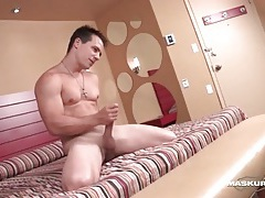 Sexy guy strokes big cock and showers tubes