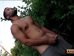 Latin guy jerks off and pisses outdoors tubes