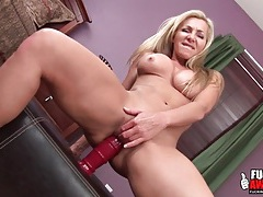 Milf sits on a big dildo and stretches her hole tubes