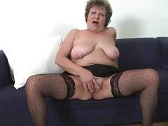 Saggy tits granny masturbates in stockings tubes
