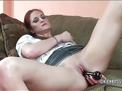 Redhead has naughty fun with her dildos tubes