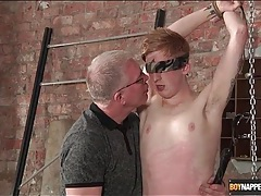 Master blows this cute boy in bondage tubes