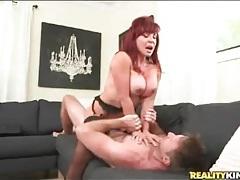Redhead mom with amazing big tits sucks cock tubes