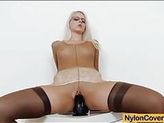 Nylon fetish girl in stockings and pantyhose tubes
