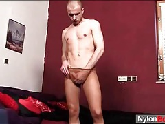 Soft tan pantyhose on his legs as he strokes tubes