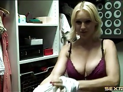 Busty blonde gets dressed in her closet tubes