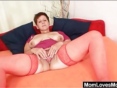 Old babe in red stockings pleasures her pussy tubes