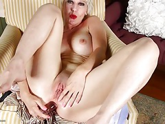 Short hair blonde mature with a toy up her ass tubes