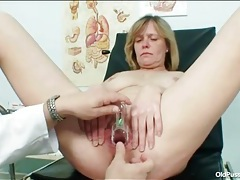Sexy mature in the chair for gyno exam tubes