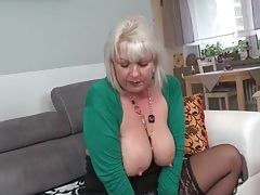 Mature pulls her panties aside and rubs her cunt tubes