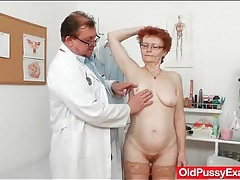 Mature redhead in stockings for her doctor tubes