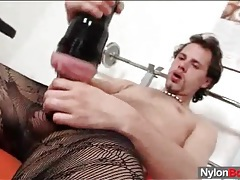 Solo guy jerks off in patterned pantyhose tubes