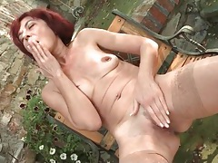 Old redhead plays with her nipple ring tubes