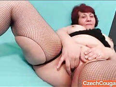 Chubby mature redhead in fishnets masturbates tubes