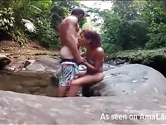 Amateur couple fucks on a rock in the river tubes