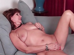 Chubby mature slowly fucks a toy into her pussy tubes