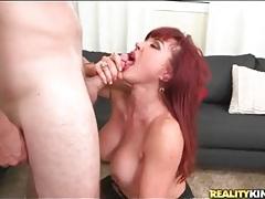 Curvy mature redhead with fake tits sucks dick tubes