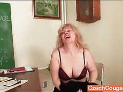 Chubby teacher strips in class and toys her cunt tubes