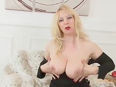 Milf in a tight black dress exposes her big tits tubes