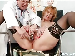 Doctor closely examines her mature pussy tubes