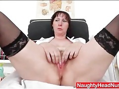Sexy mature fucks her pussy with a speculum tubes