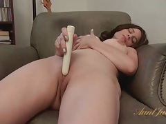 Shaved milf pussy pleasured by a vibrating toy tubes