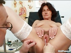 Speculum inside the cunt of the mature redhead tubes