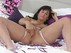 Masturbating mom in a pair of fishnets tubes