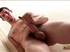 Hot guy with a goatee masturbates his dick tubes