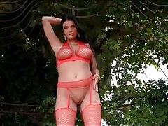 British babe emma leigh models red fishnet lingerie tubes