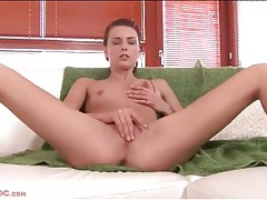 Skinny babe with a pierced belly button plays solo tubes