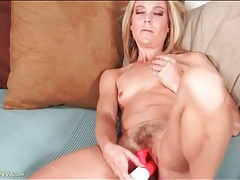 Hairy mom vagina fucked by a red dildo tubes
