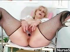 Fat lady in fishnets shows pussy in close up tubes