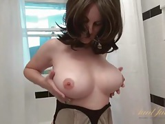 Buxom milf rubs lotion into her naked body tubes
