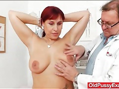 Gynecologist gives his patient a pap smear tubes