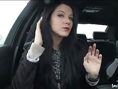 Raven haired babe lights up a cigarette in the car tubes