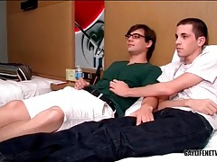 Passion between sexy twinks in bed tubes