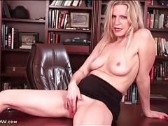 Mature secretary gently rubs her slippery pussy tubes