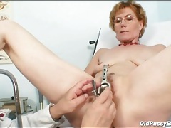 He cleans out her pussy and looks inside tubes