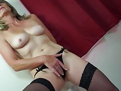 Sexy thong and stockings on a masturbating milf tubes