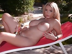 Naked babe and a champagne bottle have fun tubes