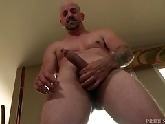 Daddy bear lubes up and strokes his dick tubes